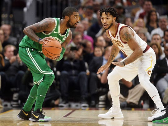 Boston Celtics guard Kyrie Irving (11) works against Cleveland Cavaliers guard Derrick Rose (1) during the first quarter at Quicken Loans Arena.