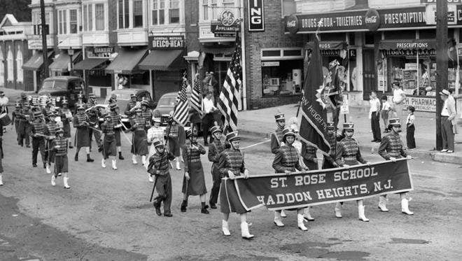 Members of the color guard and marching band from the St. Rose school in Haddon Heights participate in the town's Fourth of July celebration in this undated file photo.