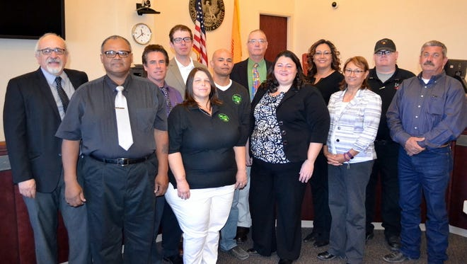 Adult Drug Court members are, from left: Sixth District Court Judge Daniel Viramontes, Court Surveillance Officer Eric Wells, Department of Corrections Probation Officer Robert Wieck, Sixth District Assistant District Attorney Anderson Hatfield, Patricia Plowman and David Leadbetter of Recovery Management Services, public defender Steven Stevers, Sixth District Court Judge Jennifer DeLaney, Sixth District Court Program Manager Rachel Pelz, Sixth District Court Administrative Assistant Rosemary Chavira, Luna County Detention Center Lieutenant David Townsend and Luna County Sheriff Office Investigator Bobby Brookhouser.