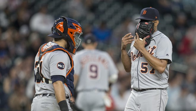 Tigers catcher Alex Avila and relief pitcher Francisco Rodriguez meet at the pitcher's mound during the seventh inning of the Tigers' 9-6 loss Thursday in Seattle.