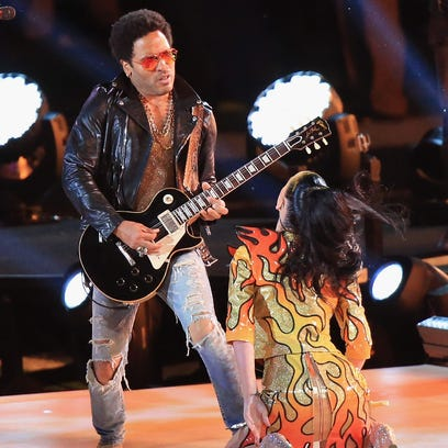 Lenny Kravitz performs with Katy Perry during the Pepsi Super Bowl XLIX Halftime Show at University of Phoenix Stadium on February 1, 2015 in Glendale, Arizona.