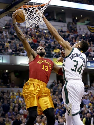 Indiana Pacers forward Paul George (13) is fouled by Milwaukee Bucks forward Giannis Antetokounmpo (34) as he drives to the basket in the first half of their game Wednesday, April 6, 2016, evening at Bankers Life Fieldhouse.