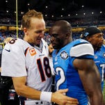 Denver Broncos quarterback Peyton Manning (18) meets with Detroit Lions strong safety James Ihedigbo after an NFL football game, Sunday, Sept. 27, 2015, in Detroit. The Broncos defeated the Lions 24-12.