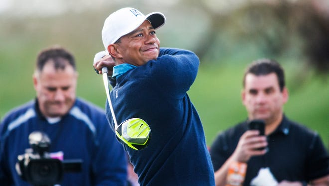 Tiger Woods tees off on the 9th tee during a practice round at the Waste Management Phoenix Open at TPC Scottsdale on Tuesday. Jan 27, 2015.