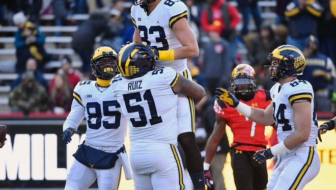 Michigan tight end Zach Gentry (83) is congratulated by teammates after scoring a touchdown against Maryland on Saturday.