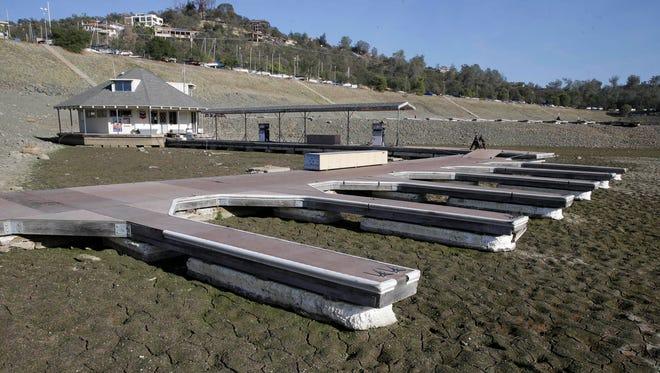 Boat slips sit on the dry lake bed at Brown's Marina at Folsom Lake, near Folsom, Calif., on Nov. 17, 2014.