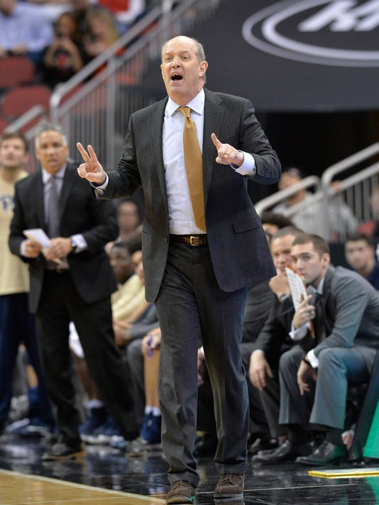 Pittsburgh coach Kevin Stallings sends a play in to his team during the second half of an NCAA college basketball game against Louisville, Tuesday, Jan. 2, 2018, in Louisville, Ky. Louisville won 77-51. (AP Photo/Timothy D. Easley)