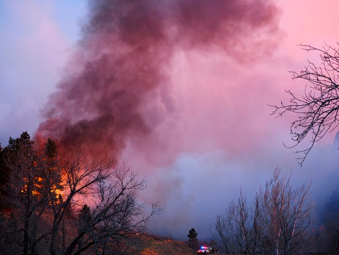 Smoke rises from a wildfire March 19, 2017, in Boulder,