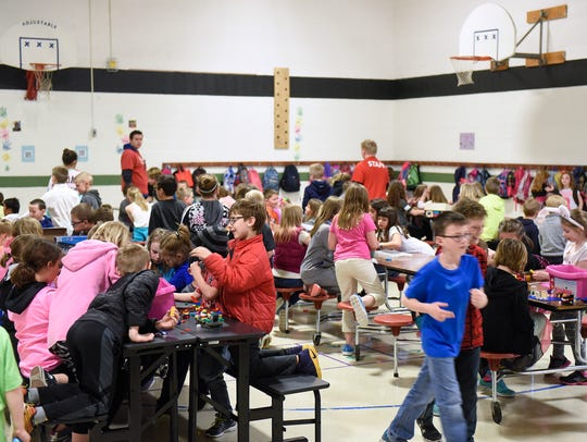 Students fill the gymnasium space for KIDSTOP activities
