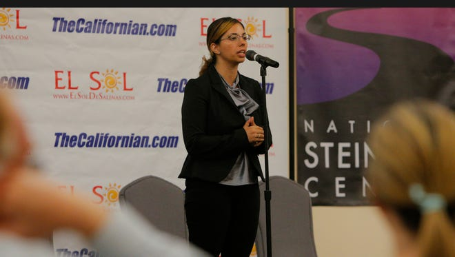 Carmen Gil speaks during the General Election Forum on Wednesday at the National Steinbeck Center in Salinas. Gil is running against Dr. Norm Nelson for the Salinas Valley Medical Healthcare System area 5 trustee.
