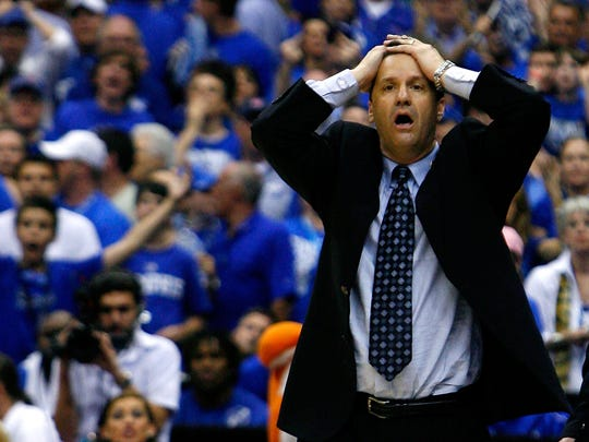 Memphis head coach John Calipari reacts after a foul