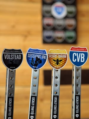Beer taps are labeled with Coachella Valley Brewing Company branding as seen in the brewery on February 17, 2015 in Thousand Palms, Calif.