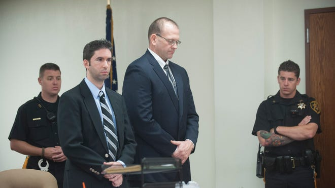 Former Gloucester Catholic High School custodian John Martin (Center Right), 43, of Wenonah, appears with his lawyer John Keating in Superior Court in Camden for his sentencing. Martin installed cameras around the school, including classrooms, the choir room, weight room, backstage area, maintenance facilities and football area. Students used some of the rooms as changing areas and some of the images captured by the cameras showed nudity, according to authorities. Friday, September 19, 2014.