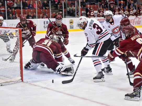 Jack Poehling gets a shot past Boston College goaltender