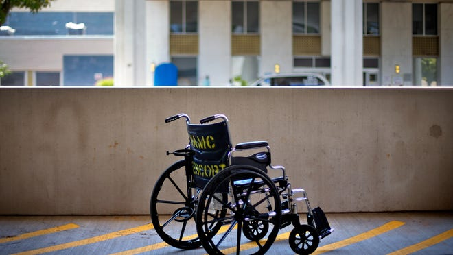 FILE - In this May 24, 2013 file photo, a wheelchair sits outside the Atlanta VA Medical Center in Atlanta. The FBI revealed on Wednesday, June 11, 2014, that it had opened a criminal investigation into a Department of Veterans Affairs reeling from allegations of falsified records and inappropriate scheduling practices. (AP Photo/David Goldman, File)