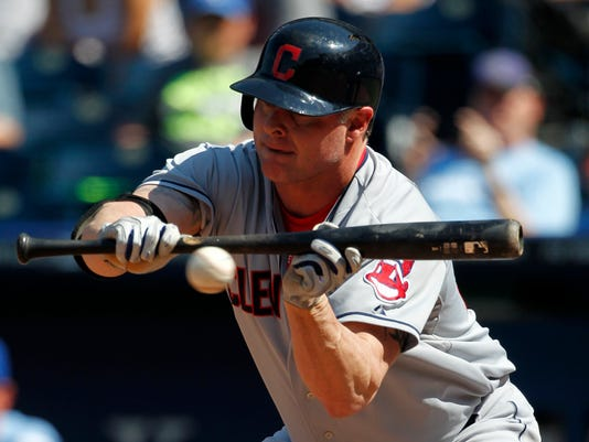 FILE- In this June 11, 2014, file photo, Cleveland Indians designated hitter Jason Giambi bunts the ball during a baseball game against the Kansas City Royals at Kauffman Stadium in Kansas City, Mo. Giambi, the American League MVP in 2000 with Oakland, told the New York Daily News on Monday, Feb. 16. 2015 that he's retiring after 20 seasons in the majors. (AP Photo/Colin E. Braley)