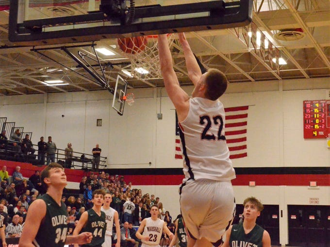 Marshall's Jeremy Luciani (22) goes up for the dunk