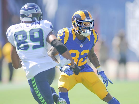 Rams cornerback Troy Hill covers Seahawks receiver Doug Baldwin during Sunday's home opener at the Coliseum.