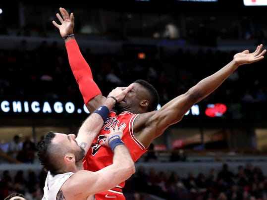 Chicago Bulls guard David Nwaba, right, is fouled by Washington Wizards center Marcin Gortat while driving to the basket during the second half of an NBA basketball game Sunday, April 1, 2018, in Chicago. The Bulls won 113-94. (AP Photo/Nam Y. Huh)