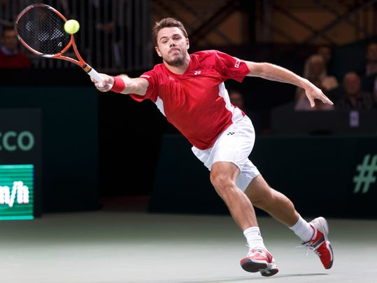Stanislas Wawrinka, of Switzerland returns a ball to Andrey Golubev of Kazakhstan during the first single match of the Davis Cup World Group quarterfinal match between Switzerland and Kazakhstan, in Geneva, Switzerland, Friday, April 4, 2014. (AP Photo/Keystone, Salvatore Di Nolfi)