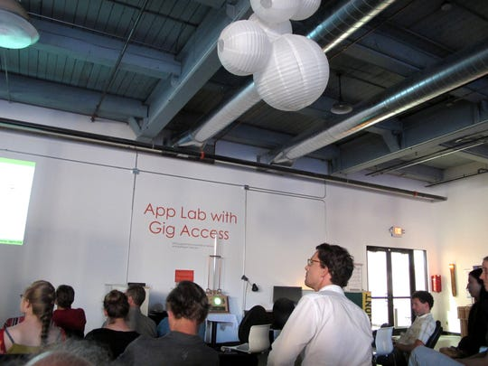 Gigabits and hands-on: A crowd gathers Thursday at Generator, a maker space at 250 Main Street, to attend a forum on art, economics and ecology.