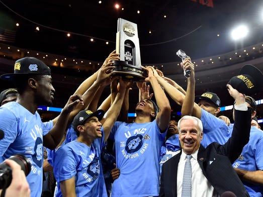 North Carolina Tar Heels head coach Roy Williams celebrates