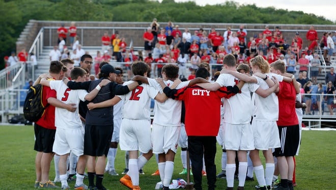 Iowa City High players huddle together Saturday, June 4, 2016, following their loss to West Des Moines Valley in the finals of the 3A boys state soccer championships in Des Moines.