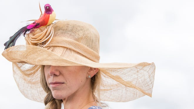 A bird tops the hat of Meghan Garrison at the 39th Annual Point-to-Point at Winterthur in Greenville on Sunday afternoon.