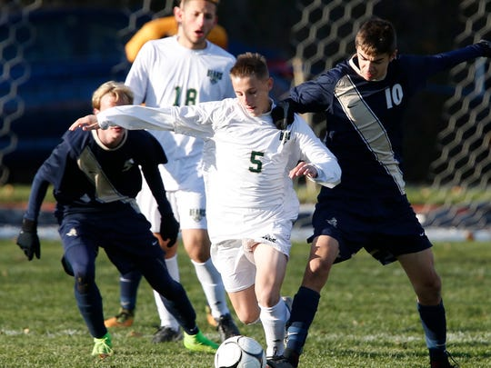 Vestal's Tristan Olmstead and Sutherland's Will Bowen battle for the ball during Saturday's Class A state semifinal at Middletown High School on November 11, 2017.