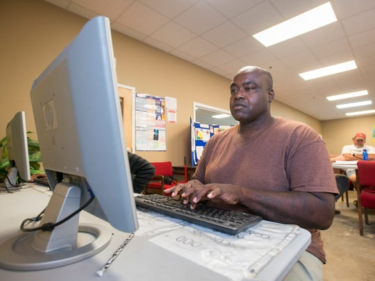 Timothy Woods uses the computer in the resource center at the Waterfront Rescue Mission in Pensacola on Wednesday, May 31, 2017.