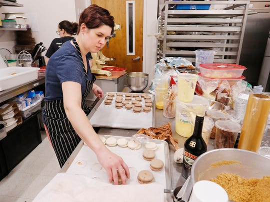 Owner Sarah Ray prepares macaroons in the kitchen of Sweet Revolution Bake Shop Friday, October 6, 2017, at 109 N. 5th Street in downtown Lafayette. Ray said the macaroons are popular with shoppers at the Lafayette Farmers Market.