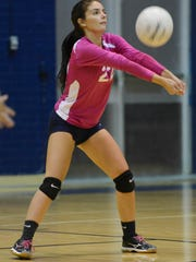 Cocoa Beach's Adrianna Prado bumps the ball during their match against Space Coast Wednesday evening.