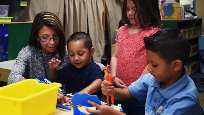 Jason Bean/RGJ Teacher's assistant Michelle Rivera works with pre-kindergarten students at Booth Elementary School in Reno on Aug. 27.