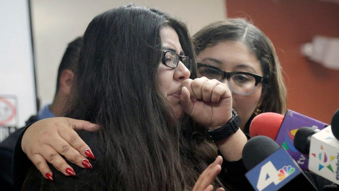 Marlene Mosqueda (left) says her father, 50-year-old house painter Manuel Mosqueda, was arrested by federal deportation agents who went to his house looking for someone else. Immigration and Customs Enforcement arrested about 160 people during a five-day sweep in Southern California this week.
