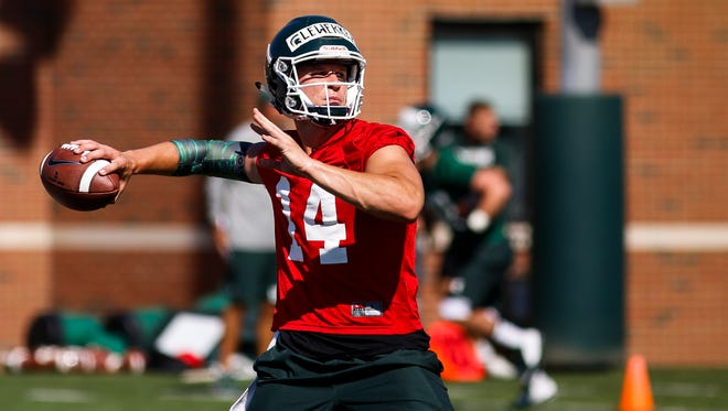 MSU redshirt sophomore Bryan Lewerke throws Monday during MSU's first practice of the season.