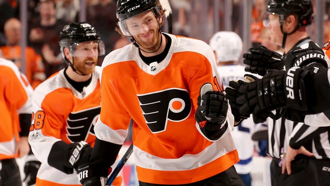 Sean Couturier celebrates his game-winning goal with teammates on the bench Tuesday night.
