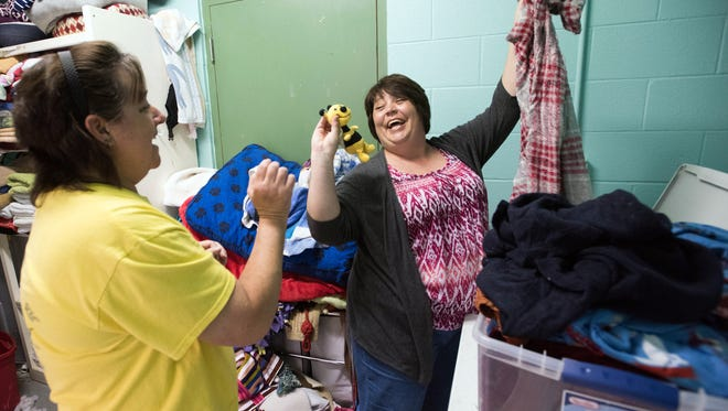 Sheri Kincaid left and Darra Flanagan, spend time doing taking care of the laundry at the Pensacola Humane Society Friday, March 23, 2018. For staffers and volunteers at the animal shelter tending the organization's mountains of dirty and soiled linens is a never-ending job.