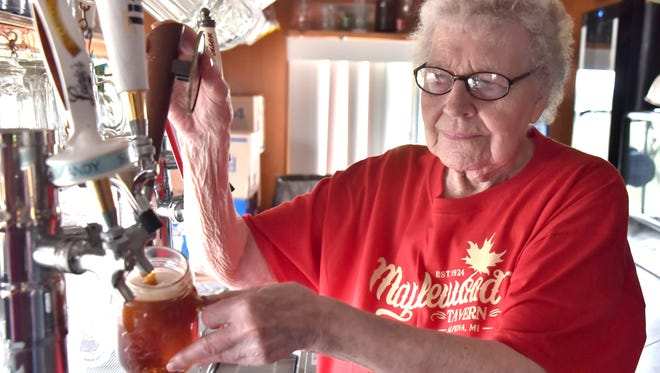 The world's longest-serving bartender, 99-year-old Clarise Kramer Cadarett Grzenkowicz, draws a beer at the 94-year-old Maplewood Tavern.