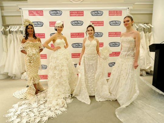 The top three winning wedding dress designs and the fan favorite, left, are modeled at the 2018 Toilet Paper Wedding Dress Contest presented by Cheap Chic Weddings and Quilted Northern, Wednesday, June 20, 2018 at Kleinfeld Bridal in New York. The fashion show finale event highlighted the top 10 designs from more than 1,500 entries submitted to the competition.