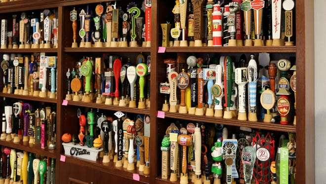 A display shows some of the more recent tap handle creations at AJS and Associates of Random Lake.