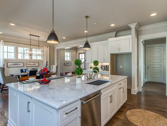The kitchen island and great room in a Volunteer Builders-built