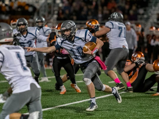 October 27 2017 - Dallastown's quarterback #10 Brett Smith points upfield as he runs the ball during Friday nights game against Central York.