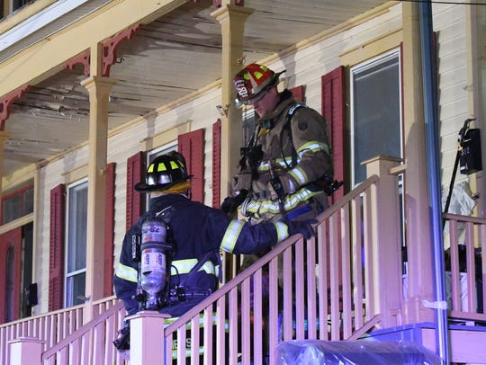 Firefighters at the scene of a second-floor fire that