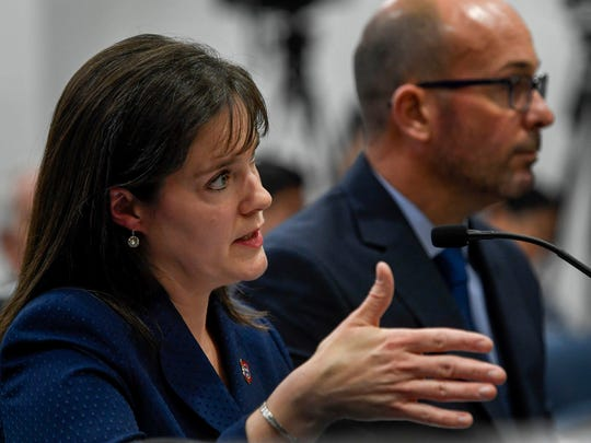 Tennessee Commissioner of Education Dr. Candice McQueen sits next to Chief Operating Officer for Questar Assessment, Brad Baumgartner as she testifies before the House Government Operations committee at the Cordell Hull Building in Nashville, Tenn., Wednesday, April 18, 2018.