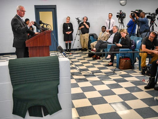 Davidson County Sheriff Daron Hall shows the media the green suicide clothing that Travis Reinking is wearing, at the Correctional Complex, Correctional Development Center in Nashville, Tenn., Tuesday, April 24, 2018.