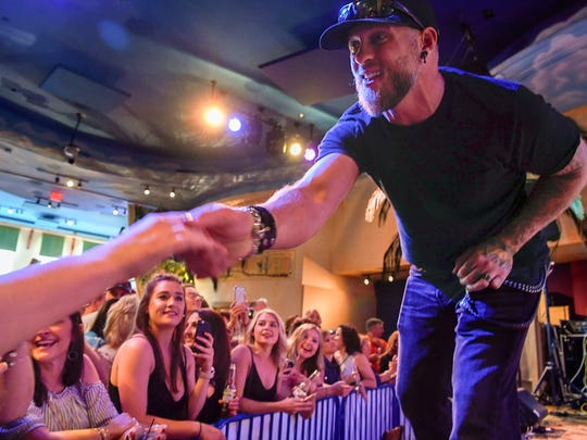 Brantley Gilbert greets fans during a taping of a radio show at Margaritaville in Nashville, Tenn., Friday, May 4, 2018.