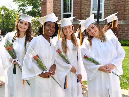 Ursuline graduates, from left, Elisabeth Olsen, Ekenedilichukwu