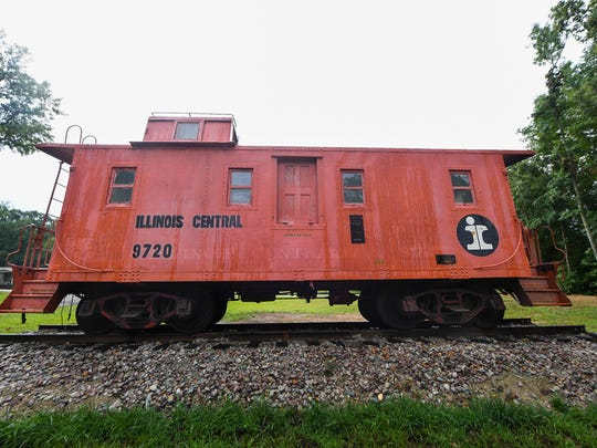 James and Deborah Grantham had their 1940s Illinois Central caboose pressure washed to show its true-red color.