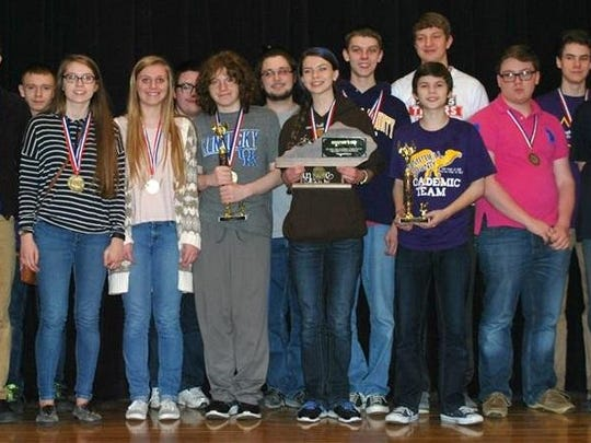 Campbell County High School students gather around their trophy for winning their regional competition in February.