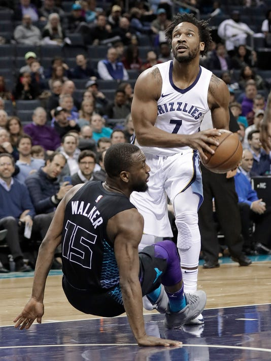 Memphis Grizzlies' Wayne Selden (7) drives into Charlotte Hornets' Kemba Walker (15) during the second half of an NBA basketball game in Charlotte, N.C., Thursday, March 22, 2018. Selden was called for a foul on the play. (AP Photo/Chuck Burton)